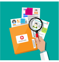 Folder and patient card hand magnifying glass vector