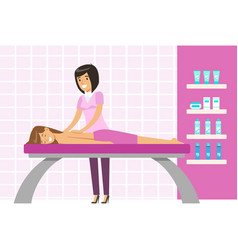 Young woman having a massage in a wellness studio vector
