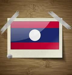 Flags Laos at frame on wooden texture vector image