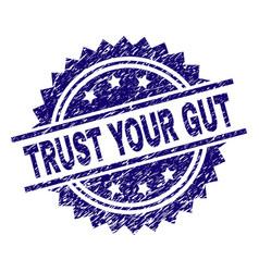Grunge textured trust your gut stamp seal vector