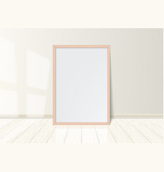 wooden frame with poster standing on white floor vector image