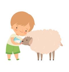 Cute little boy feeding lamb with milk bottle vector