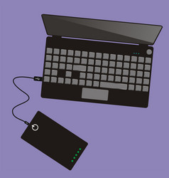 laptop connected to power bank top view vector image