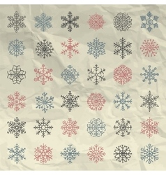 Winter Snow Flakes Doodles on Crumpled vector image