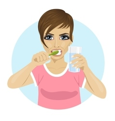 woman brushing teeth holding glass of water vector image