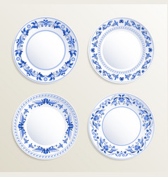 Vintage plates painted at gzhel style vector