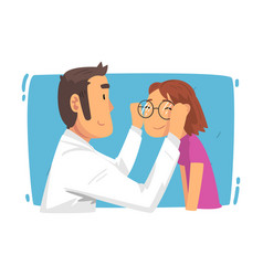 ophthalmologist doctor helping girl patient vector image