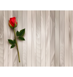 Single red rose on a wooden background vector