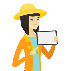 Young asian farmer holding tablet computer vector