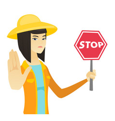 Young asian farmer holding stop road sign vector