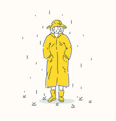 a young girl dressed in yellow raincoat and hat vector image