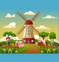cartoon two boy is herding pigs in the windmill bu vector image