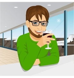 handsome man with glasses drinking wine vector image
