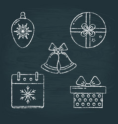 Set of christmas icons sketches on chalkboard vector