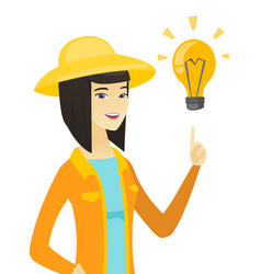 young asian farmer pointing at idea light bulb vector image