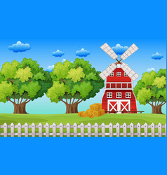 Farm scene with windmill in the field vector