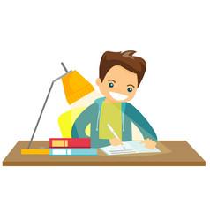 caucasian white schoolboy doing homework vector image