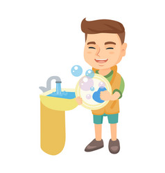 Little caucasian boy washing dishes in the sink vector