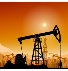 Silhouette pump jack at sunset vector
