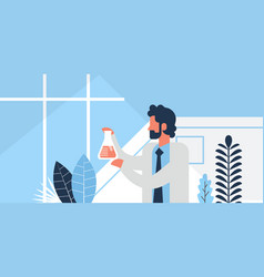 Male researcher working glassware pharmaceutical vector