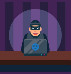 hacker using his computer for crime and hacking vector image