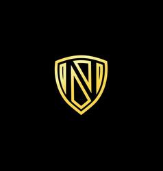 letter n emblem logo gold shield logo design vector image