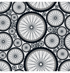 Seamless pattern with bike wheels vector