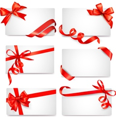 Set card notes with red gift bows with ribbons vector