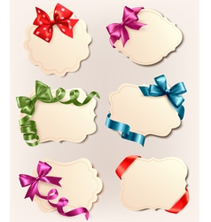 set of retro labels with red gift bows and ribbons vector image