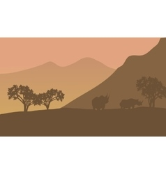 Rhino silhouette on the mountain vector image