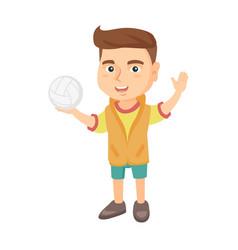 Little caucasian boy holding a volleyball ball vector