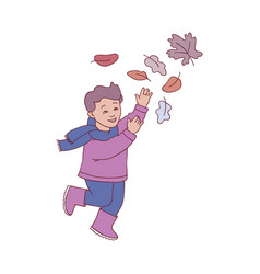 Kid boy playing with autumn vector