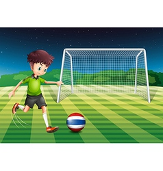 A soccer player kicking the ball with the flag of vector image