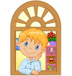 Cartoon little boy smiling and watching out the wi vector