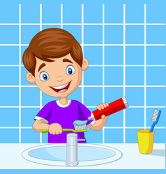 cute little boy brushing teeth in bathroom vector image