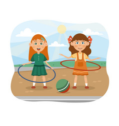 Two cute little girls playing with hula hoops vector