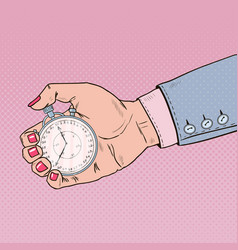 pop art female hand holding stopwatch vector image