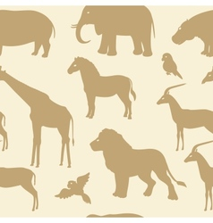 Seamless pattern with african animal silhouettes vector
