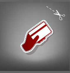 Hand holding a credit card red icon with vector