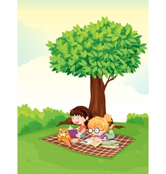 Girls studying under tree vector image vector image