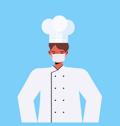 Chef in uniform wearing mask to prevent vector