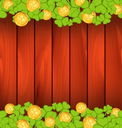 Clovers and golden coins on brown wooden vector image