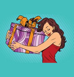 beautiful young woman hugging gift box vector image vector image