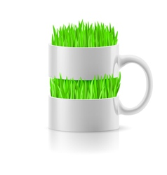 White mug with insertion of grass vector