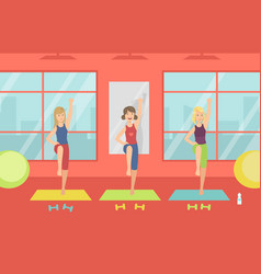 young women doing aerobic exercises in gym vector image
