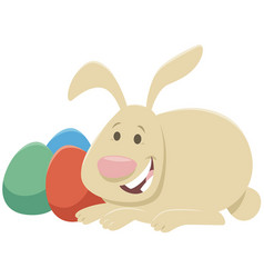 cartoon easter bunny with painted easter eggs vector image