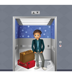 A boy with two travelling bags inside the elevator vector image