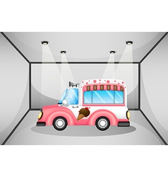 A pink ice cream car inside the garage vector image