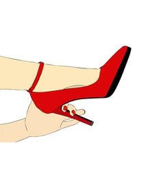 A womans hand holds the heel of the shoe vector image