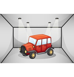 A red jeep inside the garage vector image